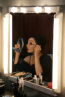 Royal Ballet dancer Tamara Rojo applies make up backstage for her role as Manon