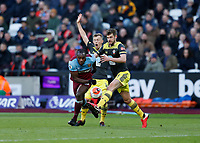 29th February 2020; London Stadium, London, England; English Premier League Football, West Ham United versus Southampton; Michail Antonio of West Ham United runs past Jack Stephens and James Ward-Prowse of Southampton