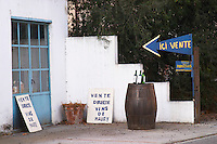Ici vente, here sale of wine, buy here, owner selling directly, plenty of advertising. Maury. Roussillon. The wine shop and tasting room. France. Europe.