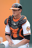 Baltimore Orioles catcher Michael Ohlman (64) in the bullpen during a spring training game against the Philadelphia Phillies on March 7, 2014 at Ed Smith Stadium in Sarasota, Florida.  Baltimore defeated Philadelphia 15-4.  (Mike Janes/Four Seam Images)