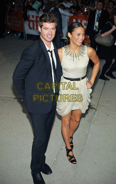 Singer Robin Thicke and wife actress Paula Patton are ending their eight-year marriage.  File Photo: 13 September 2009 - Toronto, Ontario, Canada.  &quot;Precious&quot; premiere during the 34th Annual Toronto International Film Festival held at Roy Thomson Hall.  <br /> CAP/ADM/BPC<br /> &copy;Brent Perniac/AdMedia/Capital Pictures