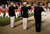 Washington, DC - July 24, 2009 -- United States President Barack Obama, right, Marine Commandant James T. Conway, center, and Washington Marine Corps Barracks Commander Colonel Andrew H. Smith, left, salute the colors during the Evening Parade at the Washington Marine Barracks on Friday, July 24, 2009.   .Credit: Kristoffer Tripplaar / Pool via CNP