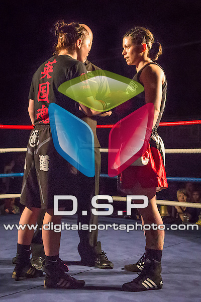 Molly McCann VS Toyah Chapman. Photo by: Stephen Smith<br /> <br /> Warrior Fight Nights 4 - Sunday 31st May 2014. The Littledown Centre, Bournemouth, Dorset, United Kingdom.