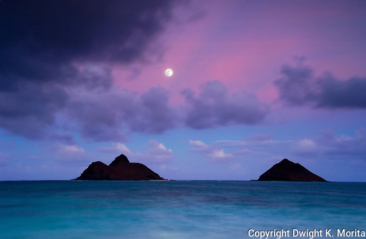 Moonrise over Mokulua Islands from Lanikai Beach, in the twilight just after sunset