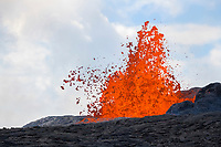 lava from the east rift zone of Kilauea Volcano erupts from a fissure on Pohoiki Road, just outside of the Puna Geothermal Ventures power plant, by Leilani Estates subdivision, near Pahoa, Puna, Big Island, Hawaii, USA