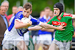 Paul Kennelly Shannon Rangers in action against Donal Maher Kilcummin in the County Championship in Listowel on Sunday