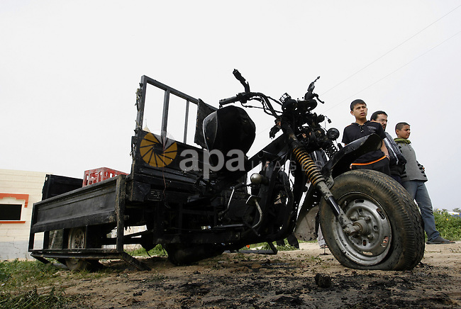 A Palestinian man reacts next to a rickshaw following an Israeli air strike in Khan Younis in the southern Gaza Strip on March 12, 2012. Israeli air strikes killed two Palestinian militants and wounded 25 civilians in the Gaza Strip on Monday, medical sources said, as cross-border hostilities continued into a fourth day. Photo by Abed Rahim Khatib