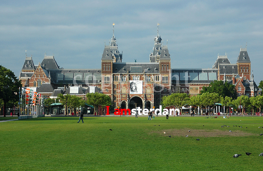 I amsterdam letters. An introduction, a slogan, a statement of inclusion, and a physical icon - I amsterdam is the city's and its resident's collective catch phrase. Located at the back of the Rijksmuseum on Museumplein, the large I amsterdam slogan quickly became a city icon and a much sought after photo opportunity. Visitors photograph themselves, in, around and on top of the slogan, and it always manages to inspire the novice photographer. Source: http://www.iamsterdam.com