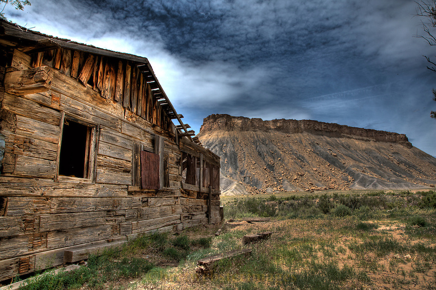 An abandoned dwelling passes time near it's only companion...a beautiful Mesa in the Book Cliffs.