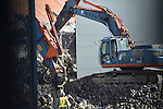 March 4, 2015, Tokyo, Japan -  Work starts to demolish the stands of Tokyo's National Stadium on March 4, 2015 in Tokyo, Japan. The National Stadium was used as the main venue for the 1964 Tokyo Olympics and is scheduled to be replaced by a new 80,000 capacity stadium designed by Zaha Hadid in time for the 2019 Rugby World Cup and the 2020 Summer Olympic Games. The whole project is expected to cost over 170 billion Yen. (Photo by Kenjiro Matsuo/AFLO)