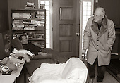 """Michael Schwallie 43 (left) who is autistic, falls asleep in his chair at the Sobolevitch House, while George Bonnell, father to Scott one of Michael's roommates, catches a glimpse of a Sesame Street episode on the television in Robbinsville, NJ., on Sunday December 12, 2005. The Sobolevitch House, was one of Eden's first group home and has been home to Michael for more then 20 years. Autism was relatively not known at the time Michael was diagnosed around the age of 4 1/2. In fact, his pediatrician in Cleveland, Ohio accused Michael's parents for """"creating an angry child"""" and giving no """"consistency"""" in the parenting of young Michael. Michael who has 5 other siblings, has a younger brother with Asperger's syndrome which is similar to autism. Autism a neurological disorder and is on the rise in America. It is estimated that 1.5 million Americans are afflicted. There is no known cure for autism nor no known origin. Those families afflicted with the disease, have a greater chance of having a child with some form of autism. This includes the siblings offspring as well. photo by jane therese"""