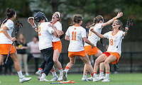 Newton, Massachusetts - May 11, 2018: NCAA Division I. In overtime, Princeton University (white) defeated Syracuse University (blue), 12-11, at Newton Campus Lacrosse Field.<br /> Overtime victory.