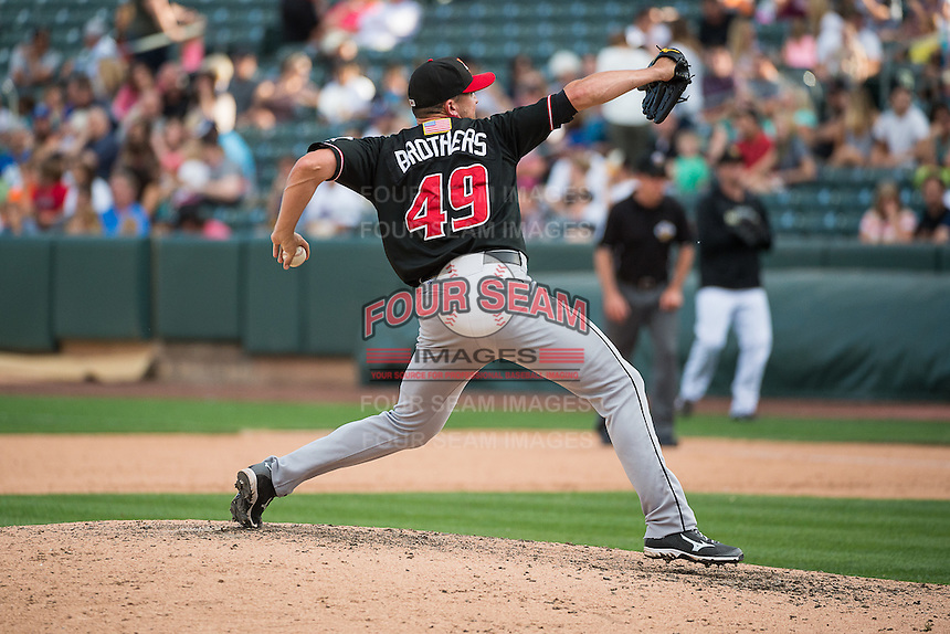Rex Brothers (49) of the Albuquerque Isotopes delivers a pitch to the plate against the Salt Lake Bees in Pacific Coast League action at Smith's Ballpark on June 8, 2015 in Salt Lake City, Utah. This was Game 2 of a double-header originally scheduled on June 6, 2015.  (Stephen Smith/Four Seam Images)