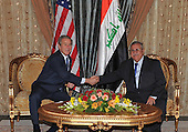 Baghdad, Iraq - December 14, 2008 -- United States President George W. Bush, left, shakes hands with President Jalal Talabani of Iraq at Salam Palace during his fourth unannounced visit to Baghdad on Sunday, December 14, 2008. .Credit: Office of the President of Iraq via CNP