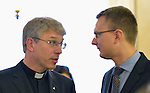 The Rev. Dr Olav Fykse Tveit (left), general secretary of the World Council of Churches, talks with Bence Retvari, the Parliamentary State Secretary of the Hungarian government Ministry of Human Resources on September 26, 2015. The conversation was part of a visit to Hungary by leaders of the World Council of Churches (WCC), the Conference of European Churches (CEC) and the Churches' Commission for Migrants in Europe (CCME). The visit sought to strengthen efforts to support refugees and migrants. Members of the delegation met with Hungarian church leaders, government officials and members of international organizations.