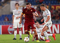 Calcio, Champions League, Gruppo E: Roma vs CSKA Mosca. Roma, stadio Olimpico, 17 settembre 2014.<br /> Roma forward Francesco Totti, left, is challenged by CSKA Moskva defender Sergei Ignashevic during the Group E Champions League football match between AS Roma and CSKA Moskva at Rome's Olympic stadium, 17 September 2014.<br /> UPDATE IMAGES PRESS/Isabella Bonotto