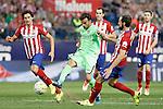 Atletico de Madrid's Stefan Savic (l) and Juanfran Torres (r) and Getafe's Pedro Leon during La Liga match.September 22,2015. (ALTERPHOTOS/Acero)