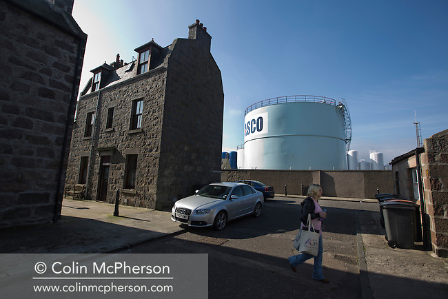A woman crossing a street in the historic Footdee area of Aberdeen, a traditional fishing village which sits next to the city's harbour, Scotland's North Sea oil and gas transportation and maintenance hub. Issues surrounding oil and gas has been one of the key political battlegrounds between supporters of Scottish independence and those who prefer Scotland to remain within the United Kingdom. On the 18th of September 2014, the people of Scotland voted in a referendum to decide whether the country's union with England should continue or Scotland should become an independent nation once again and leave the United Kingdom.