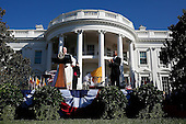 U.S. President Barack Obama (R) applauds as Pope Francis (L) prepares to speak at an arrival ceremony at the White House on September 23, 2015 in Washington, DC. The Pope begins his first trip to the United States at the White House followed by a visit to St. Matthew's Cathedral, and will then hold a Mass on the grounds of the Basilica of the National Shrine of the Immaculate Conception.<br /> Credit: Win McNamee / Pool via CNP