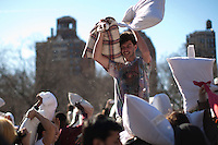 People take part in the world's 6th annual Pillow Fight Day in Washington Square Park in New York, April 06, 2013. VIEWpress /Kena Betancur