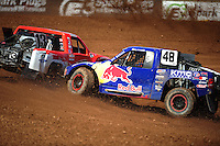 Apr 15, 2011; Surprise, AZ USA; LOORRS driver Ricky Johnson (48) hits John Harrah (13) during round 3 and 4 at Speedworld Off Road Park. Mandatory Credit: Mark J. Rebilas-.