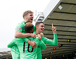 Moussa Dembele celebrates with Stuart Armstrong and Mikael Lustig
