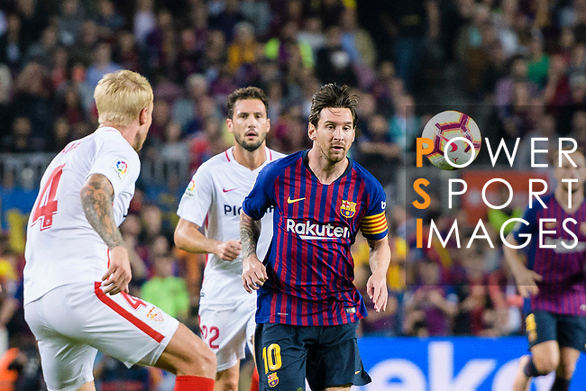 Lionel Messi of FC Barcelona (R) fights for the ball with Simon Kjaer of Sevilla FC (L) during the La Liga 2018-19 match between FC Barcelona and Sevilla FC at Camp Nou Stadium on October 20 2018 in Barcelona, Spain. Photo by Vicens Gimenez / Power Sport Images