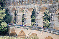 breakaway group over the ancient/famous aquaduct 'Pont du Gare'<br /> <br /> Stage 16: Nîmes to Nîmes (177km)<br /> 106th Tour de France 2019 (2.UWT)<br /> <br /> ©kramon