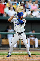 Chattanooga Lookouts outfielder Noel Cuevas (13) at bat during game three of the Southern League Championship Series against the Jacksonville Suns on September 12, 2014 at Bragan Field in Jacksonville, Florida.  Jacksonville defeated Chattanooga 6-1 to sweep three games to none.  (Mike Janes/Four Seam Images)