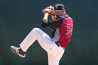 Wisconsin Timber Rattlers pitcher Cy Sneed (34) warms up in the bullpen prior to a game against the Peoria Chiefs on April 25th, 2015 at Fox Cities Stadium in Appleton, Wisconsin.  Wisconsin defeated Peoria 2-0.  (Brad Krause/Four Seam Images)