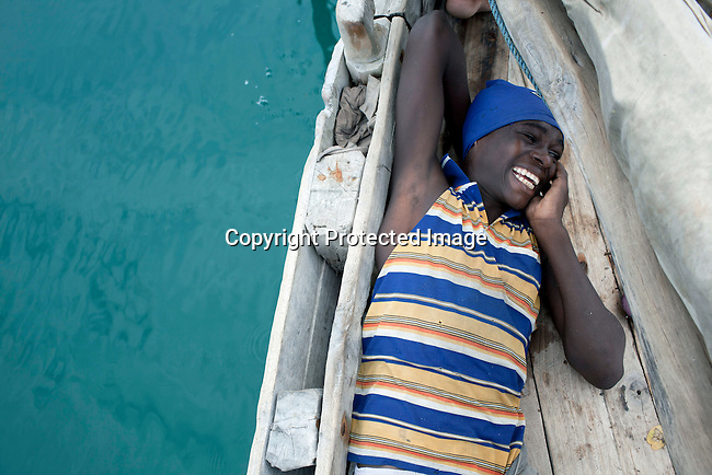 PEMBA, TANZANIA - DECEMBER 7 : Hamissi Usi, age 15, rests after been on a boat the entire day on December 7, 2010 on Pemba, Tanzania. He works as a fisherman. He doesn't go to school but lives with his parents and siblings in the small village of Tumbe. (Photo by: Per-Anders Pettersson