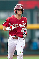 Arkansas Razorbacks outfielder Andrew Benintendi (16) jogs around the bases after slugging a home run against the Virginia Cavaliers in Game 1 of the NCAA College World Series on June 13, 2015 at TD Ameritrade Park in Omaha, Nebraska. Virginia defeated Arkansas 5-3. (Andrew Woolley/Four Seam Images)