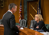 """Arne M. Sorenson, President and Chief Executive Officer, Marriott International, Inc, left, speaks with United States Senator Maggie Hassan (Democrat of New Hampshire) prior to giving testimony before the United States Senate Committee on Homeland Security and Governmental Affairs Permanent Subcommittee on Investigations during a hearing on """"Examining Private Sector Data Breaches"""" on Capitol Hill in Washington, DC on Thursday, March 7, 2019.<br /> Credit: Ron Sachs / CNP/AdMedia"""