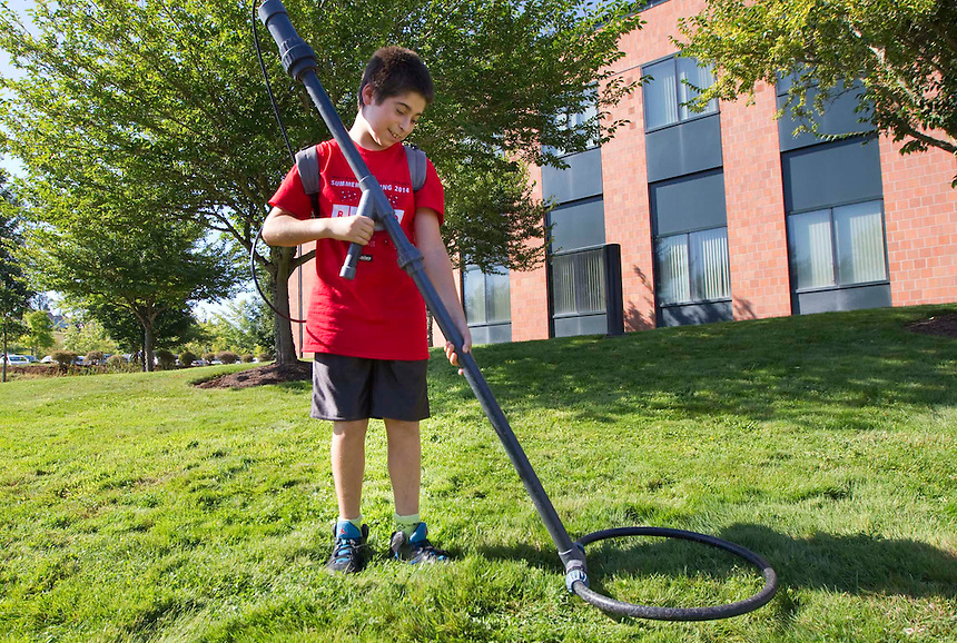 Ethan Eisner, 12 tests a PIT tag detector , which can be used to track salmon, at an open house part of the 25th anniversary celebration of WSUV at the campus in Vancouver, Saturday September 6, 2014. The anniversary festivities included an open house, music, food, and historical displays. (Natalie Behring/for the Columbian)