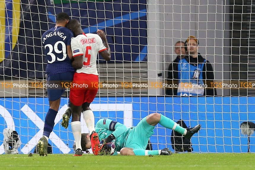 Dayot Upamecano of RB Leipzig and Japhet Tanganga of Tottenham Hotspur clash as Hugo Lloris of Tottenham Hotspur collects the ball during RB Leipzig vs Tottenham Hotspur, UEFA Champions League Football at the Red Bull Arena on 10th March 2020