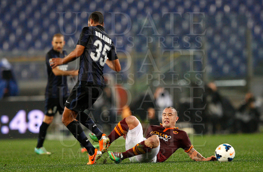 Calcio, Serie A: Roma vs Inter. Roma, stadio Olimpico, 1 marzo 2014.<br /> AS Roma midfielder Radja Nainggolan, of Belgium, right, is challenged by FC Inter defender Jorge Pires da Fonseca Rolando, of Capo Verde, during the Italian Serie A football match between AS Roma and FC Inter at Rome's Olympic stadium, 1 March 2014.<br /> UPDATE IMAGES PRESS/Riccardo De Luca