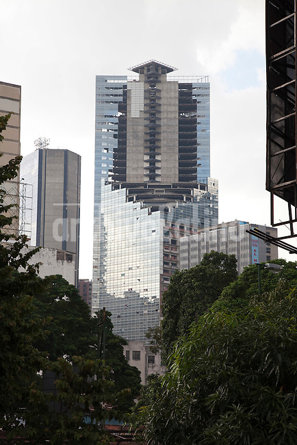 In 1990 Venezuelan banker David Brillembourg began to build a forty storey, glass-clad skyscraper in Caracas, crowned by an heliport, aimed to  transform a part of downtown Caracas into a Wall Street-style financial district. Brillembourg , also known as  &quot;King David&quot;, spent in &quot;David's Tower&quot; project  a part of the fortune he got in the stock markets in the 8o&acute;s.<br />
