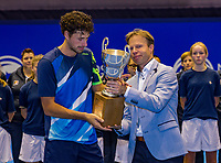 Rotterdam, Netherlands, December 17, 2017, Topsportcentrum, Ned. Loterij NK Tennis, Final man's single: Winner Robin Haase (NED) recieven the trophy from KNLTB director Erik Poel<br /> Photo: Tennisimages/Henk Koster