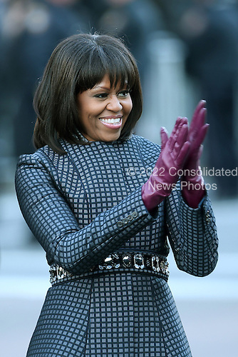 First lady Michelle Obama walks the route as the presidential inaugural parade winds through the nation's capital January 21, 2013 in Washington, DC. Barack Obama was re-elected for a second term as President of the United States.  .Credit: Chip Somodevilla / Pool via CNP