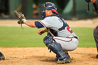 Rome Braves catcher Ryan Query #25 sets a target during the South Atlantic League game against the Kannapolis Intimidators at CMC-Northeast Stadium on August 5, 2012 in Kannapolis, North Carolina.  The Intimidators defeated the Braves 9-1.  (Brian Westerholt/Four Seam Images)