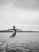 Local children play at the pier of Arborek, a small island in Raja Ampat archipelago, Indonesia.