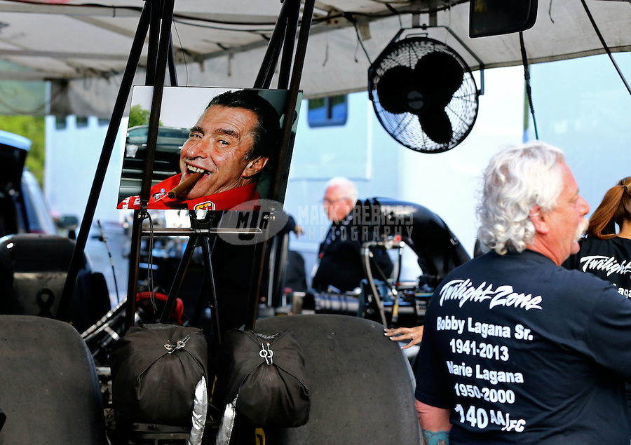May 31, 2014; Englishtown, NJ, USA; A picture of former NHRA funny car driver Bobby Lagana on display in the pits of top fuel driver Dom Lagana during qualifying for the Summernationals at Raceway Park. Mandatory Credit: Mark J. Rebilas-