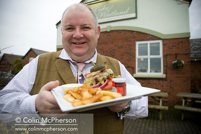 "Proprietor David Mooney photographed at the Duke of Portland in the Cheshire village of Lach Dennis, pictued with his 'Grand Duke"" beefburger, as part of the newly-established Cheshire Food Trail."