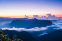 View of mountains from the 2443m summit of Adams Peak (Sri Pada) at sunrise, Sri Lanka, Asia. This is a photo of the view of mountains from the 2443m summit of Adams Peak (Sri Pada) at sunrise, Sri Lanka, Asia. Reaching the 2443m summit of Adams Peak for sunrise requires a 2am start, but is well worth it for the stunning, misty mountain view from the summit.
