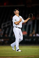 Mesa Solar Sox relief pitcher Jesus Zambrano (8), of the Oakland Athletics organization, celebrates as he walks off the field between innings of an Arizona Fall League game against the Peoria Javelinas on September 21, 2019 at Sloan Park in Mesa, Arizona. Mesa defeated Peoria 4-1. (Zachary Lucy/Four Seam Images)