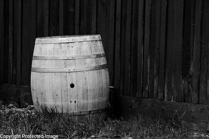 A barrel stands next to a wood barn near Calistoga in Napa County in Northern California.