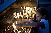 JUAZEIRO DO NORTE, CE, 01.11.2016 - DIA DO ROMEIRO - Fiéis acendem velas em frente A Capela de Nossa Senhora do Perpétuo Socorro em Juazeiro do Norte na noite desta terça-feira, 01, para homenagear Padre Cícero na véspera do feriado de finados. A Capela de Nossa Senhora do Perpétuo Socorro foi construída entre os anos de 1908 e 1909 e fica situada no início da Rua Santa Luzia, no Centro de Juazeiro. Conhecida como Capela do Socorro, a mesma está à frente do principal cemitério do município, e, no seu altar-mor, foram sepultados os restos mortais do Padre Cícero no dia 21 de julho de 1934. Por isso, tornou-se um dos lugares considerados sagrados e de grande visitação em Juazeiro, principalmente durante a Romaria de Finados, de tal forma a ser apontado como um dos túmulos mais visitados do mundo. Trata-se do único templo da cidade a ostentar imagens em vitrais do Padre Cícero e da Beata Maria de Araújo. (Foto: Levi Bianco/Brazil Photo Press)