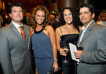 Chris Reed and Megan Sutton-Reed with Gina and Alex Matturro at the Una Notte in Italia dinner and fashion show at the InterContinental Hotel Friday Nov. 07, 2008. (Dave Rossman/For the Chronicle)