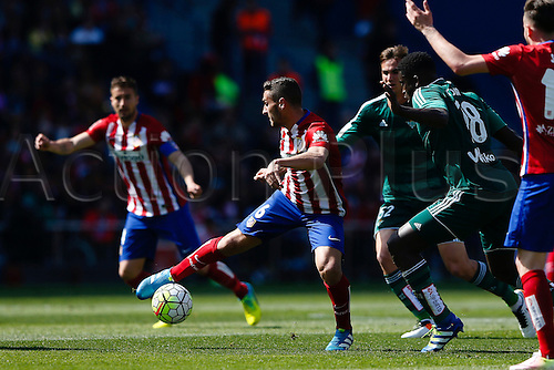 02.04.2016. Madrid, Spain.  Jorge Resurreccion Merodio (6) Atletico de Madrid gets past Alfred N'Diaye (18) Real Betis. La Liga match between Atletico de Madrid and Real Betis at the Vicente Calderon stadium in Madrid, Spain, April 2, 2016 .
