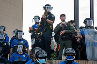 AUSTIN, TEXAS - MAY 30 Austin Law enforcement and APD Police officers armed with pepper spray and less lethal round shotguns scan the crowd of Black Lives Matter protesters at APD Headquarters on May 30, 2020 in Austin, Texas.<br /> <br /> Use of this image in advertising or for promotional purposes is prohibited.<br /> <br /> Editorial Credit: Photo by Dan Herron / Herron Stock